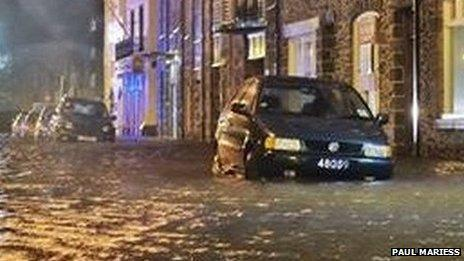 A parked car with water up to its wheels