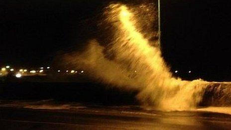 Waves crashed over harbour walls in Guernsey