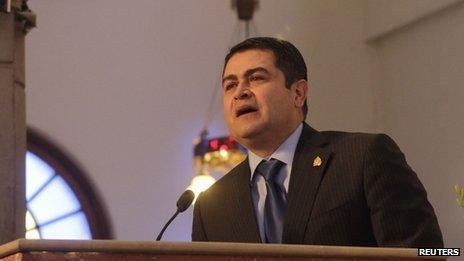 Honduran President Juan Orlando Hernandez addresses Catholics during a mass at the Basilica of Suyapa in Tegucigalpa on 3 February, 2014