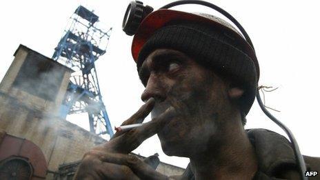 Miner smokes in front of mine in Makiyivka, eastern Ukraine (file image)
