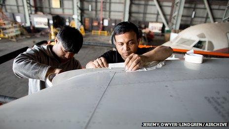 Workers prepare a DC-10