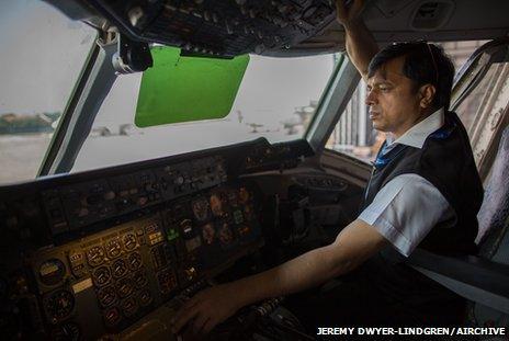 Pilot checks controls