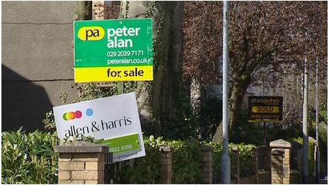 Estate agent boards outside houses in Cardiff