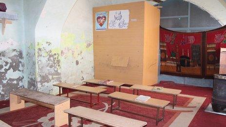 A wooden booth used by teachers in class to avoid direct contact with female students