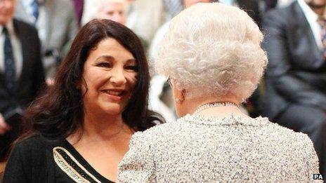 Kate Bush receives a CBE from the Queen