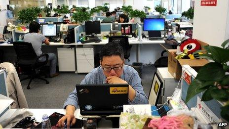 A worker at the Sina Weibo office