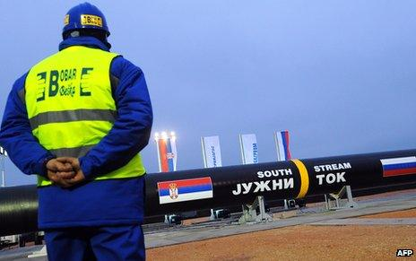 A construction worker stands in front of two giant pipes arranged to be welded together near the village of Sajkas, 80 km north of Serbian capital Belgrade, on 24 November 2013.