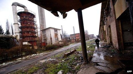 Ivanko Jankovic, a former employee, visits the site of the devastated Viskoza factory, once a proud symbol of Serbian industry, on 5 March 2014, in Loznica, western Serbia.