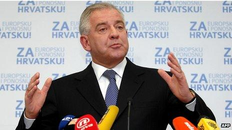 Former Croatian Prime Minister Ivo Sanader address reporters at his party headquarters following the presidential election in 2010