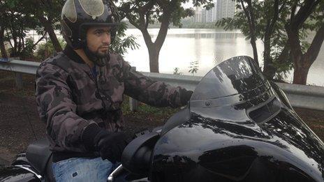 Arjan Bafna riding a Harley Davidson