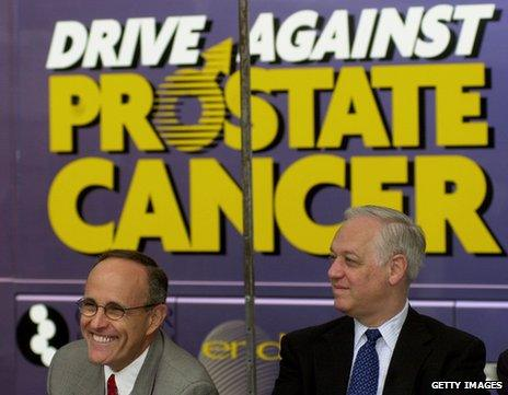 Rudy Giuliani and a fellow New York politician at a mobile medical vehicle offering free prostate cancer screenings for men
