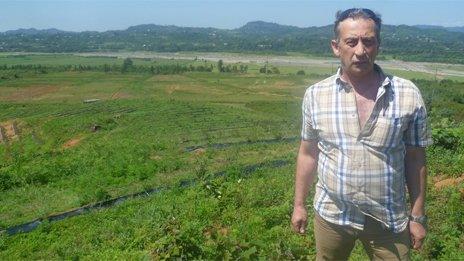 Irakli Partsvania stands at his blueberry plantation near Ureki, Georgia