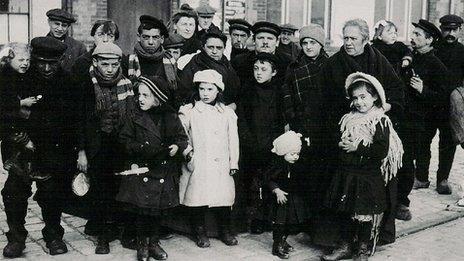 Refugees attending mass