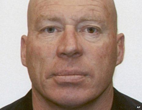 In this undated photo provided by New Zealand Police, John Henry Tully, 48, poses for a photo