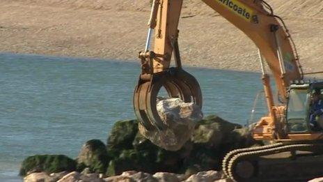Rock being moved on Pagham beach