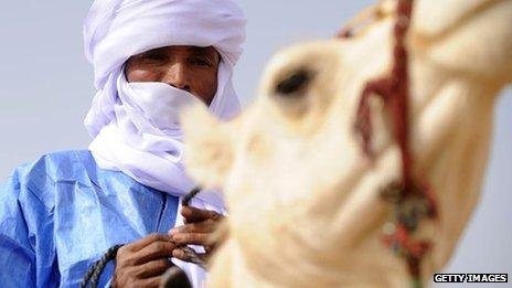 A Tuareg man on his camel during the annual festival of Assihar in Tamanrasset, Algeria