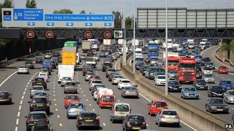 File photo dated 22/8/2014 of motorists in heavy traffic on the M25 between junction 12 and 13 near Egham, Surrey