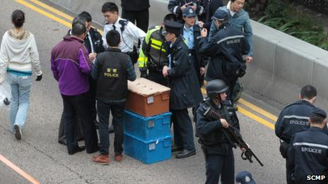 Hong Kong police surround boxes of cash after some of the money was retrieved - 24 December 2014