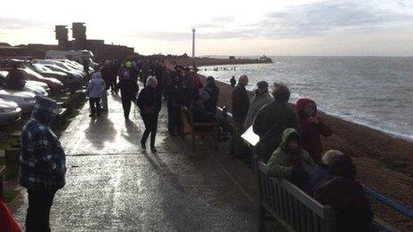 Spectators gathered to watch the ship arrive