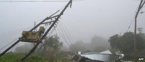 A general view of a collapsed house and broken electrical poles seen on 12 January 2015 on the outskirts of Malawian city of Blantyre