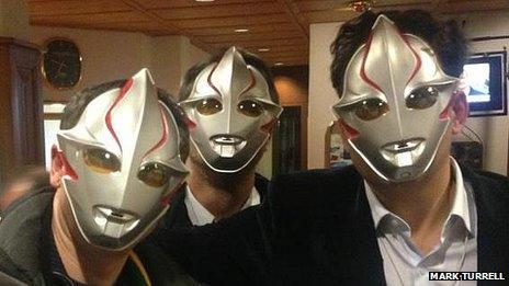 People wearing sci-fi masks