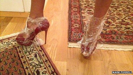 Woman wearing plastic bags over her high heeled shoes