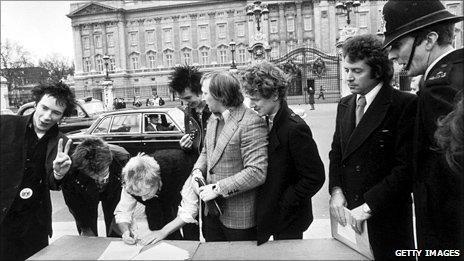 The Sex Pistols sign a record contract outside Buckingham Palace in March 1977