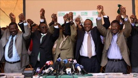 Kenyan cabinet ministers celebrate after provisional results showed that Kenyans had voted for a draft constitution they had campaigned for in Nairobi, Kenya
