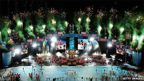 Performers dance and sing at the Opening Ceremony of the 2010 Youth Olympics