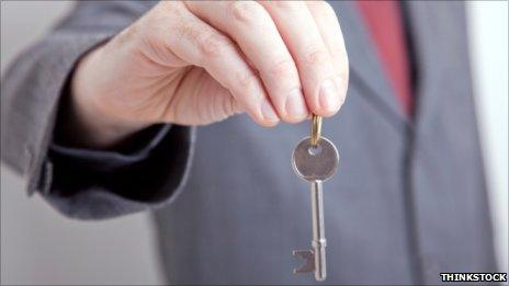 Estate agent with key