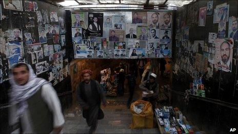 Afghans walk past election posters at a subway in Kabul, Afghanistan, on 23 August, 2010