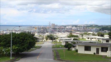 US base in Ginowan in foreground, with Okinawan residential areas in the background