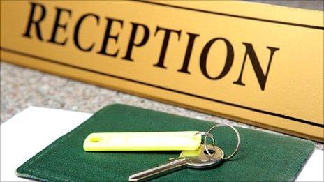 Hotel reception sign and door key