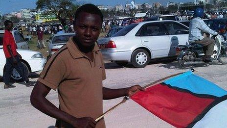 18-year old Moshi holding a flag at a campaign rally