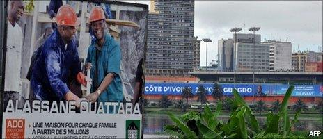 Photo taken on 19 October 2010 shows an election campaign poster for Alassane Ouattara