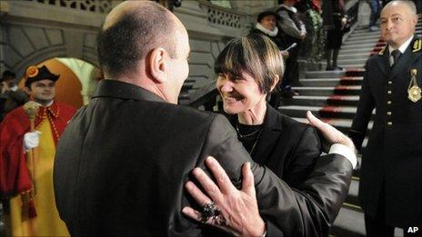 Swiss National Assembly president Jean-Rene Germanier congratulates Micheline Calmy-Rey on her election as Swiss president, 8 December