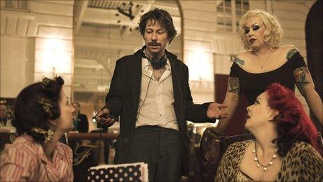 (from left) Suzanne Ramsey as Kitten on the Keys, Mathieu Amalric directing, Miranda Colclasure as Mimi Le Meaux, Linda Marraccini as Dirty Martini