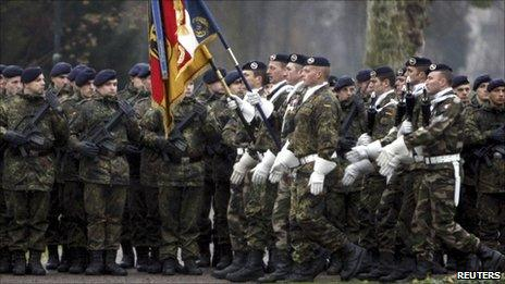 German and French soldiers parade together in Strasbourg, 10 December
