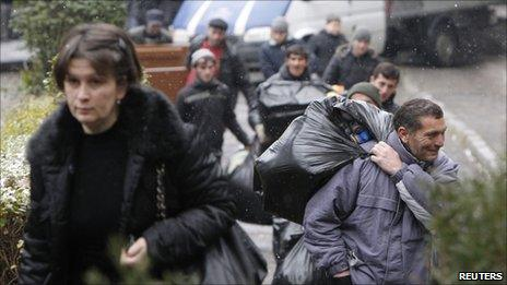 Evicted refugees leave their shelter in Tbilisi, 20 January