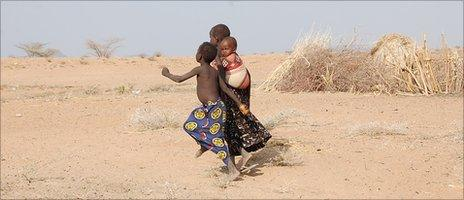 Young Turkana children heading towards road to look for water