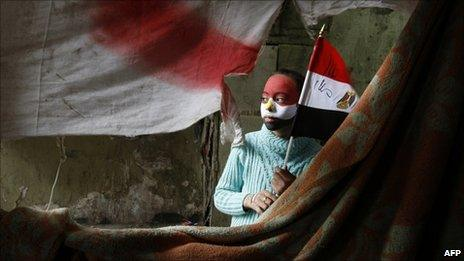 A young protester holds an Egyptian flag in Tahrir Square (7 February 2011)