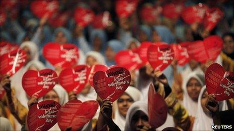 Women shout slogans for the anti-Valentine's Day Campaign, near Kuala Lumpur on 11 February 2011