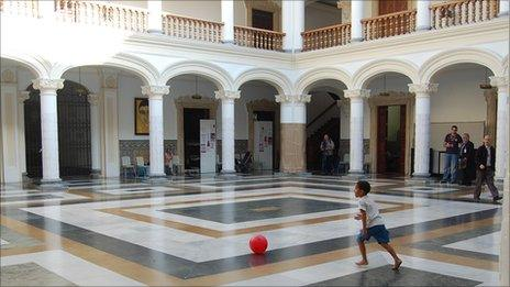 A boy plays football in the courtyard of Venezuela's foreign ministry