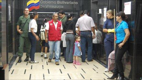 Families getting into the lift at the Venezuelan foreign ministry