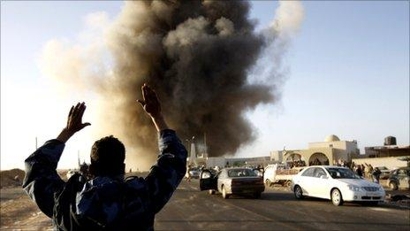 A rebel fighters reacts during an air strike in Ras Lanuf March 7, 2011