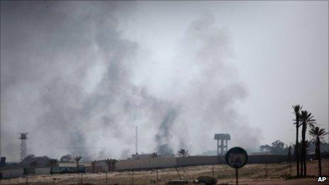 Smoke rises from a Libyan military base on the outskirt of Tajoura, east of Tripoli, March 25, 2011