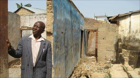 Reverend Noah Maikano in the ruins of his home