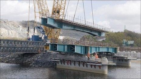 The bridge being lifted into place