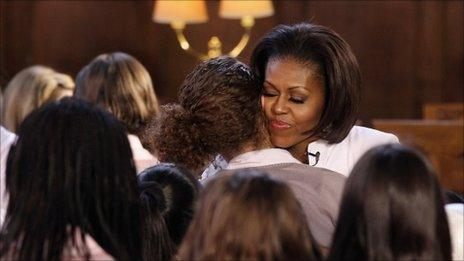 Michelle Obama hugs students at Oxford University