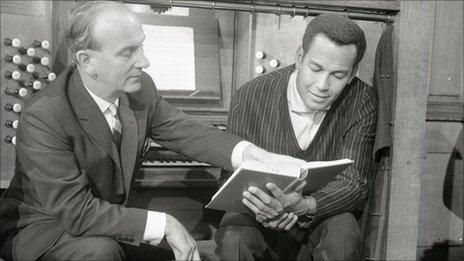 Organist Arwel Hughes and singer Cy Grant in a Songs of Praise rehearsal in 1961